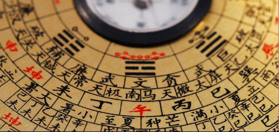 A master of classical Feng Shui uses a compass